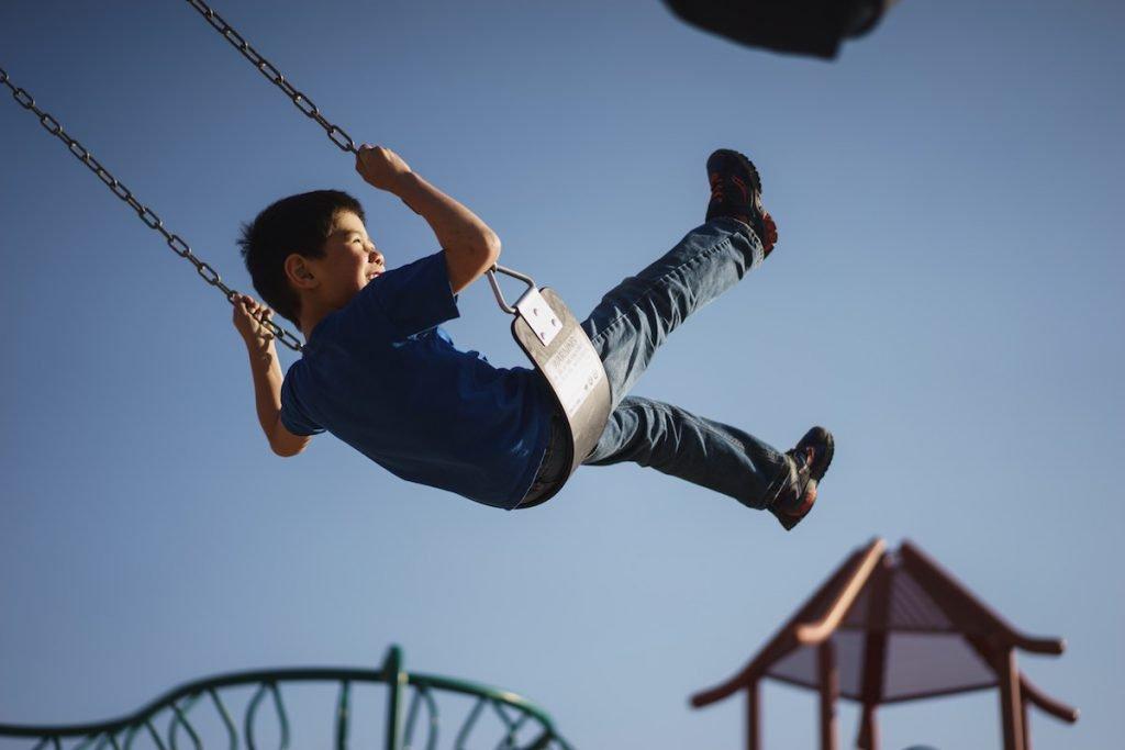 Child on swing.