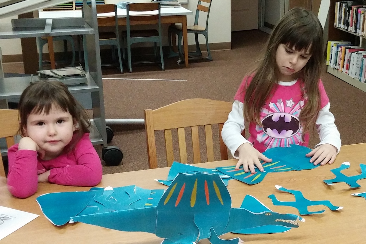 Photo of two children playing together at the library.
