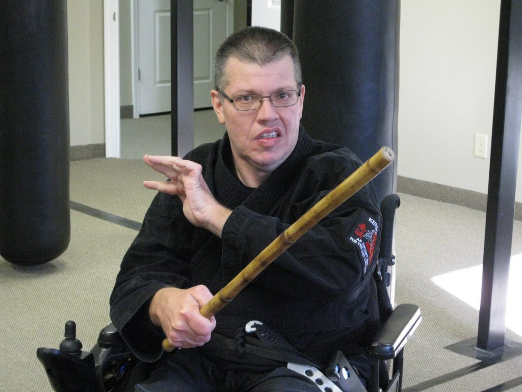 Darrell Mattingly at the dojo using a weapon.