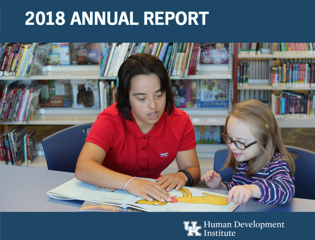 HDI Annual Report cover with Megan McCormick teaching Dailey how to read.
