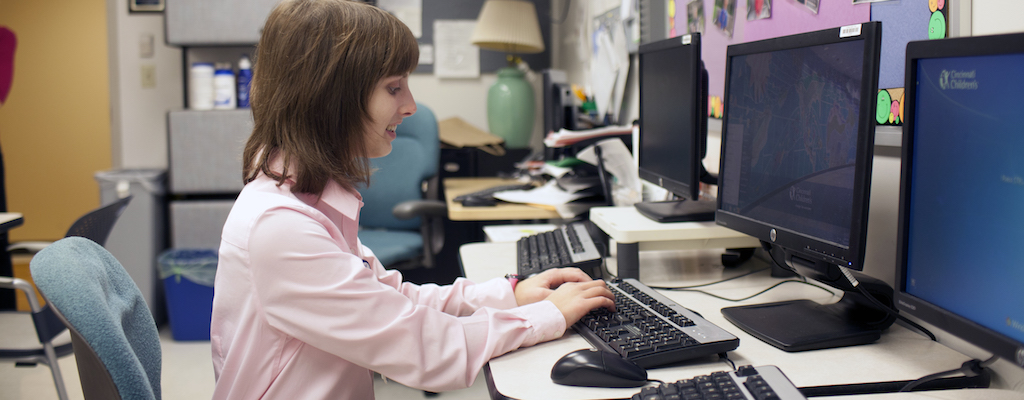 Photo of an information worker at an office workstation