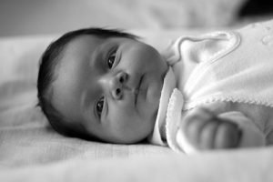 b/w photo of infant with black hair