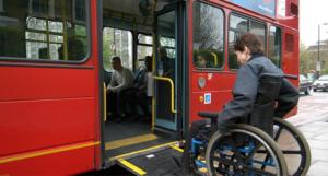 Person using a wheelchair ramp to enter a bus